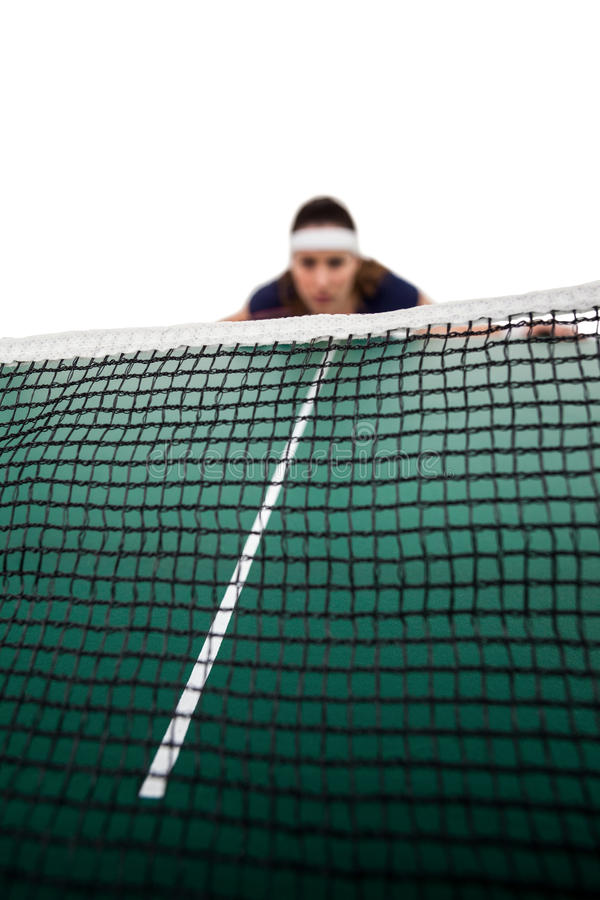 Tennis player behind net stock images