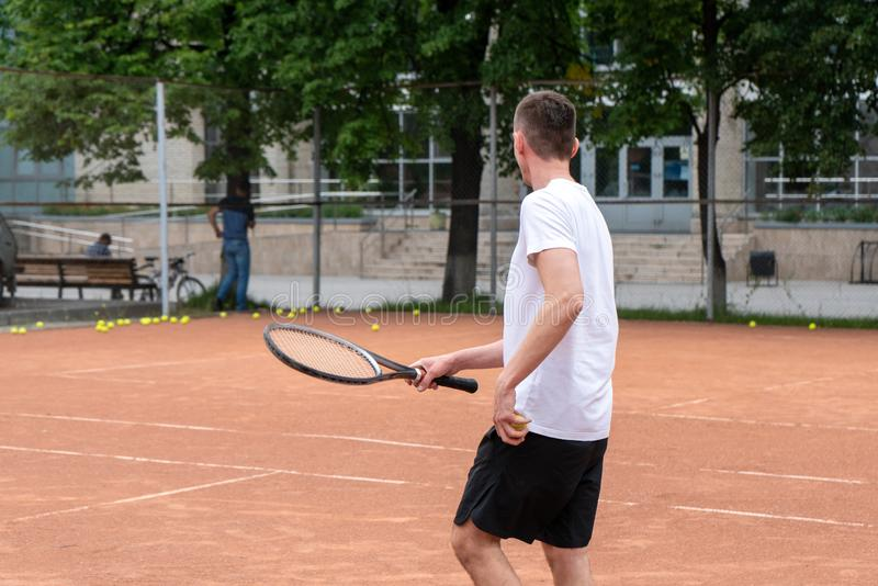 Tennis player on the court stock image