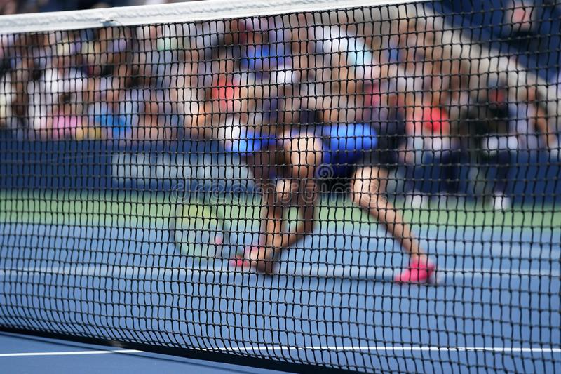 Tennis player during doubles match stock photos