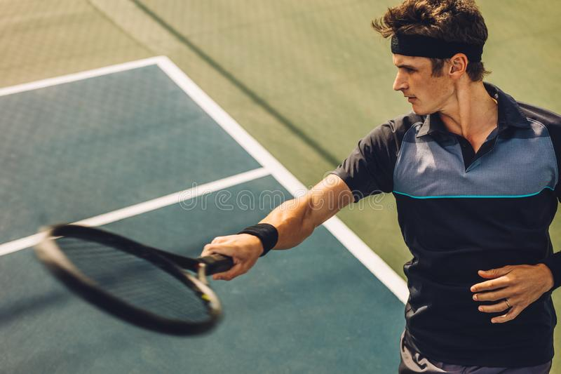 Tennis player hitting forehand from baseline stock photography