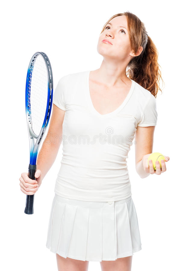 Tennis player holds a racket and ball for tennis and looks upwards on a white background royalty free stock photos