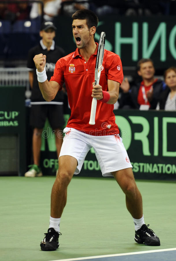 Tennis player Novak Djokovic reacts during the Davis Cup tennis match. Belgrade, Serbia - September 18, 2010: Novak Djokovic reacts during the Davis Cup World royalty free stock photo