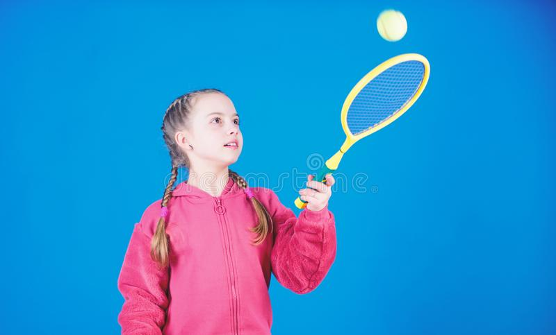 Tennis player with racket and ball. Childhood activity. Happy child play tennis. Gym workout of teen girl. Little girl. Fitness diet brings health and energy stock image