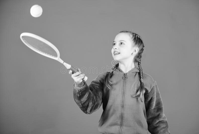 Tennis player with racket and ball. Little teen girl. Fitness diet brings health and energy. Happy child teen girl play. Tennis. Sport game success. Gym workout stock photos
