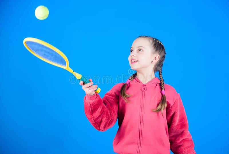Tennis player with racket and ball. Little teen girl. Fitness diet brings health and energy. Happy child teen girl play. Tennis. Sport game success. Gym workout royalty free stock images