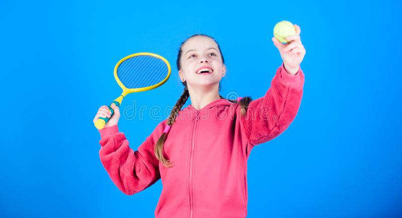 Tennis player with racket and ball. Tennis is fun. Childhood activity. Little girl. Fitness diet brings health and. Energy. Sport game. Happy child play tennis royalty free stock image