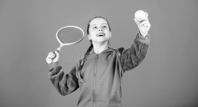 Tennis player with racket and ball. Tennis is fun. Childhood activity. Little girl. Fitness diet brings health and. Energy. Sport game. Happy child play tennis stock photos