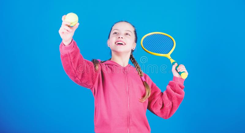 Tennis player with racket and ball. Tennis is fun. Childhood activity. Little girl. Fitness diet brings health and. Energy. Sport game. Happy child play tennis royalty free stock photography