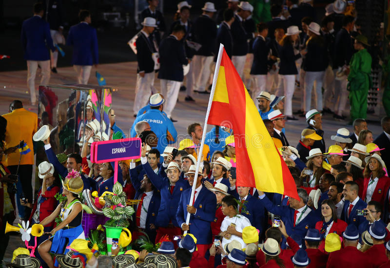 Tennis player Rafael Nadal carrying the Spanish flag leading the Spanish Olympic team in the Rio 2016 Opening Ceremony royalty free stock photo
