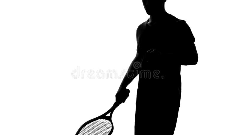 Tennis player shadow holding racket, warming up before competition, active hobby royalty free stock photography