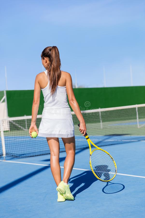 Tennis player skirt woman playing holding racket. Tennis player woman in sportswear holding racket wearing white dress outfit and running shoes. Female athlete royalty free stock image