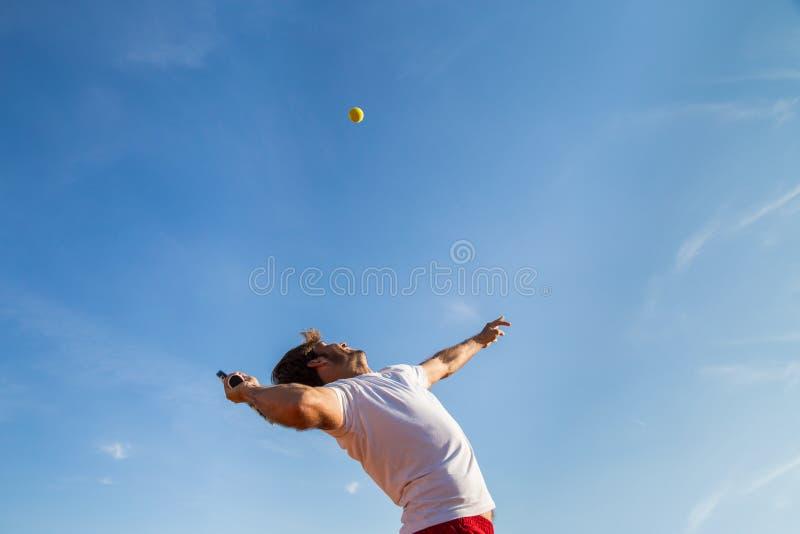 Tennis player throwing ball royalty free stock photos