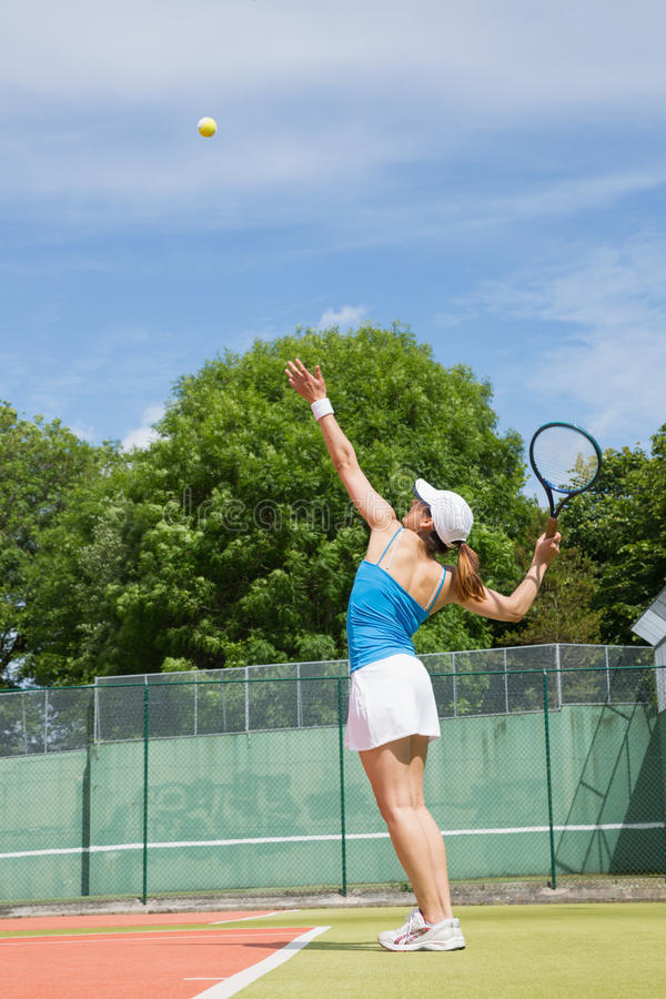 Tennis player about to serve. On a sunny day stock image