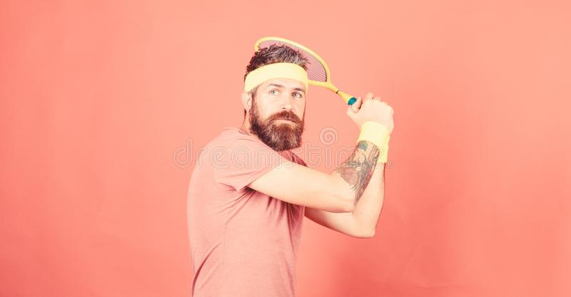 Tennis player vintage fashion. Tennis sport and entertainment. Athlete hipster hold tennis racket in hand red background royalty free stock photos