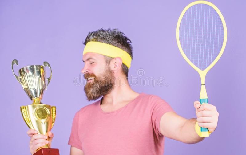 Tennis player win championship. Athlete hold tennis racket and golden goblet. Win tennis game. Man bearded hipster wear royalty free stock photos