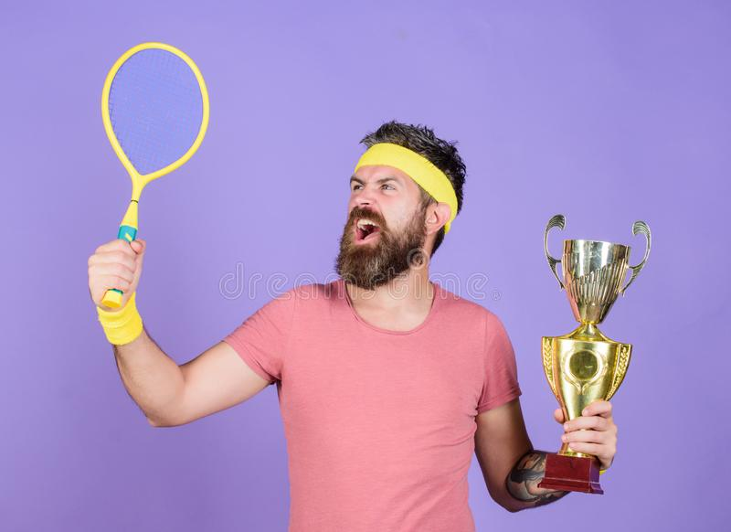 Tennis player win championship. Man bearded successful athlete. First place. Sport achievement. Tennis champion. Win. Tennis game. Celebrate victory. Athletic royalty free stock photos