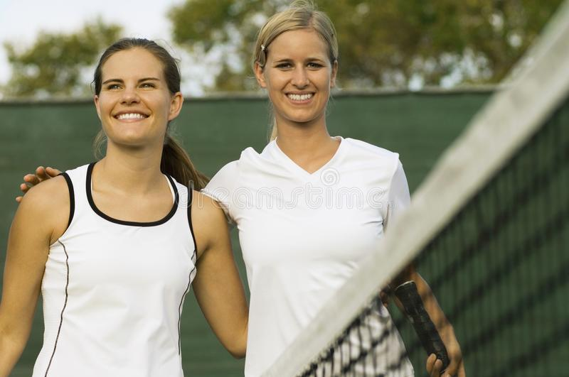 Tennis Players arms around Each Other. Over net After Match stock image