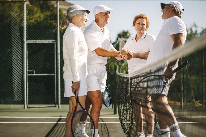Tennis players greeting each other after the match royalty free stock image