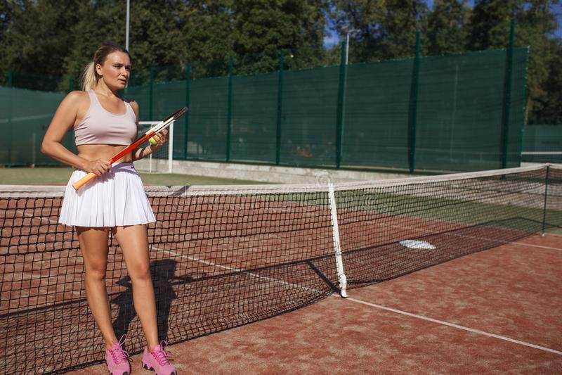 Tennis players playing a match on the court on a sunny day stock photo