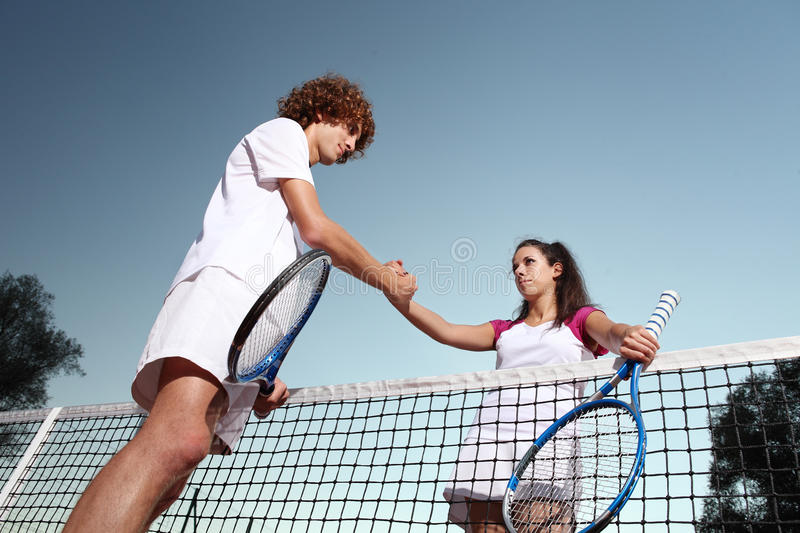 Tennis players shaking hands, fair play royalty free stock images