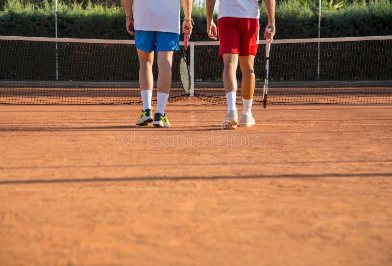 Tennis players walking towards net royalty free stock photo