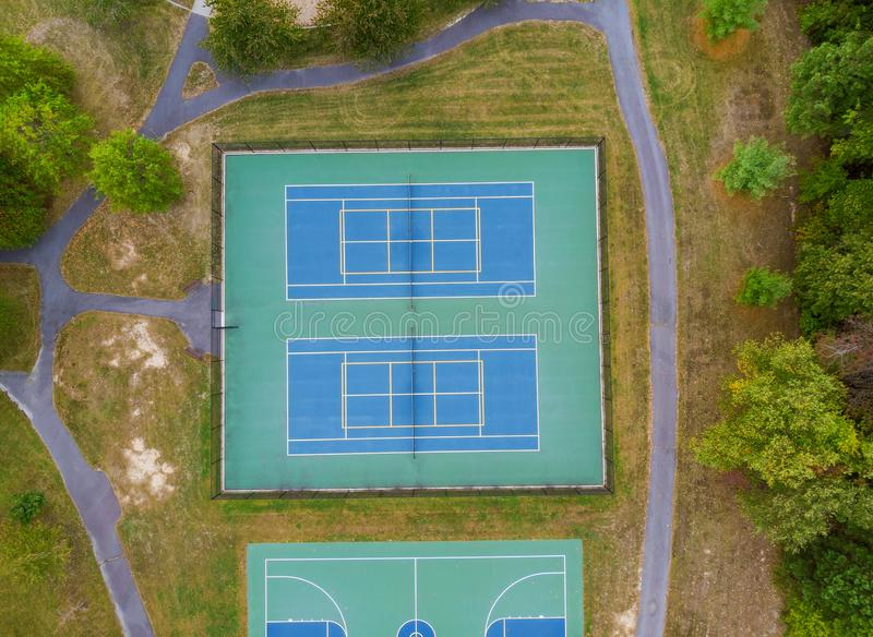 Tennis playing field a high point shot height of autumn trees. Beautiful landscape, court, basketball, sport, game, line, outdoor, competition, leisure royalty free stock images