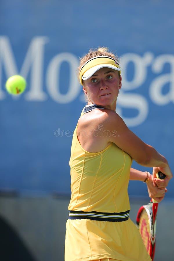 Tennis professionista Elina Svitolina dall'Ucraina durante la prima partita del giro all'US Open 2014 fotografie stock