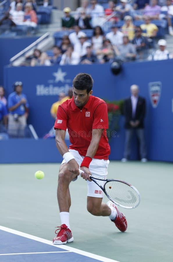 Tennis professionista Novak Djokovic durante in quarto luogo la partita del giro all'US Open 2013 fotografie stock libere da diritti