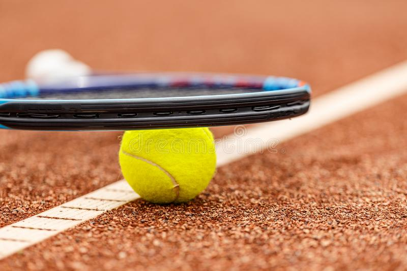 Tennis racket and ball. Placed on court ground stock images
