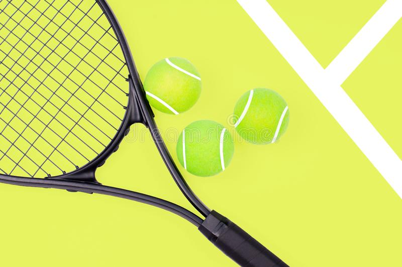 Tennis racket and ball sports on yellow background. Tennis racket and ball sports on pastel yellow background stock photo