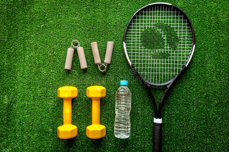 Tennis racket on green background top view.  royalty free stock photos