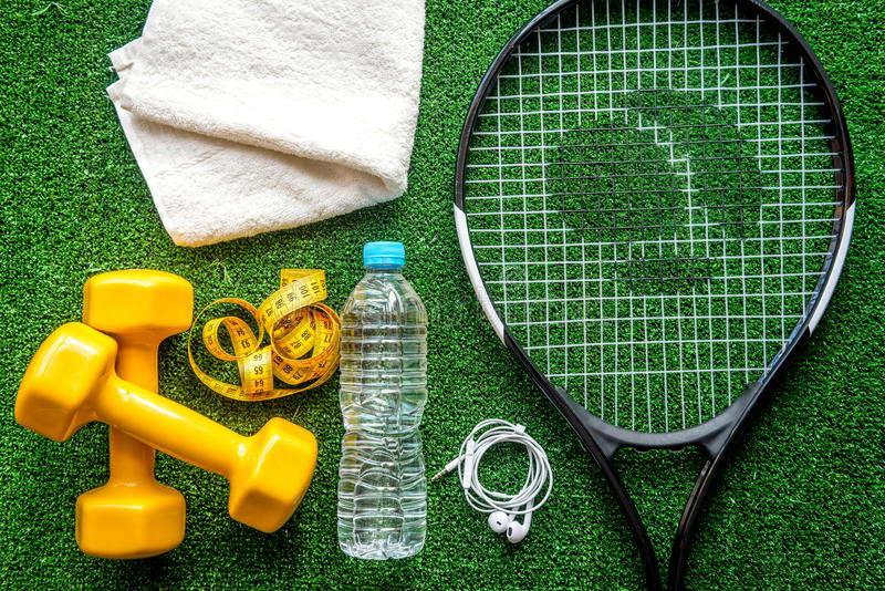 Tennis racket on green background top view.  royalty free stock photo
