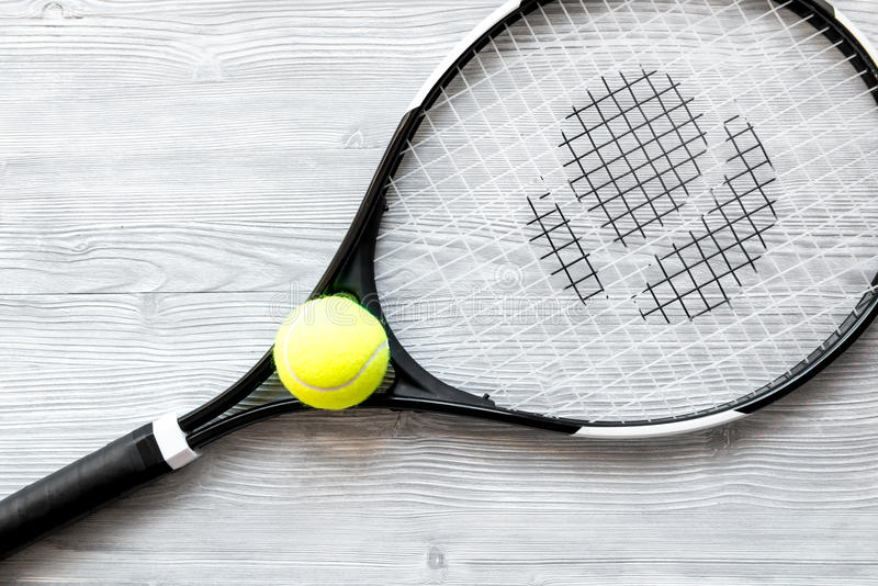 Tennis racket on wooden background top view.  stock photography