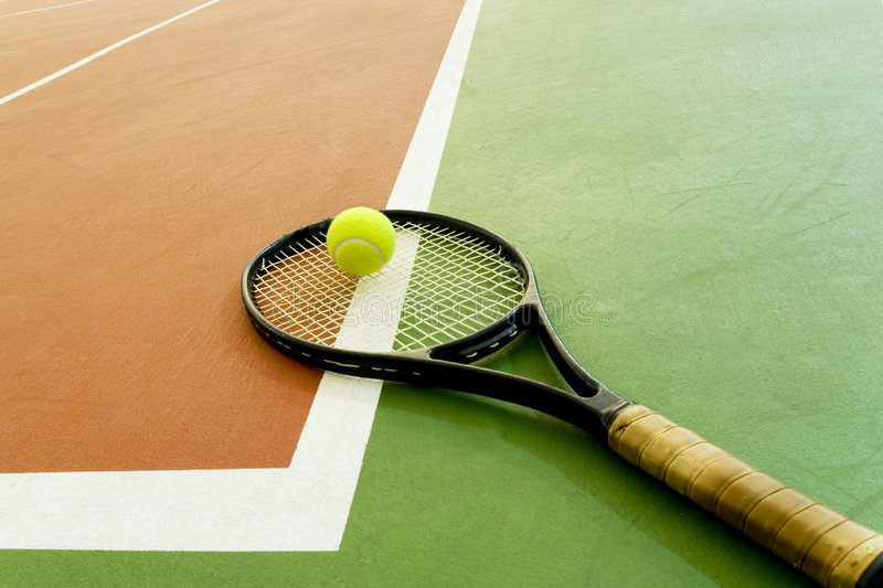 Tennis rackets on the court stock photography