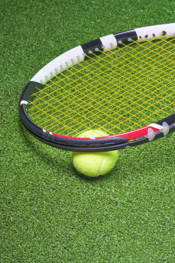 Download Tennis Racquet With Ball Over Green Artificial Grass Stock Photo - Image: 33465508