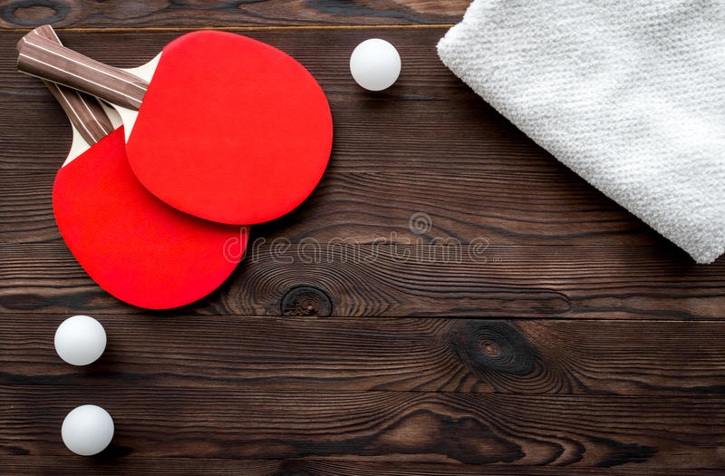 Tennis racquet - fitness in the wooden background top view.  stock photography
