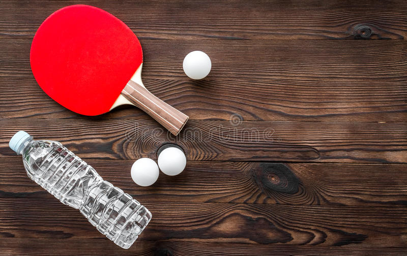 Tennis racquet - fitness in the wooden background top view.  stock photo