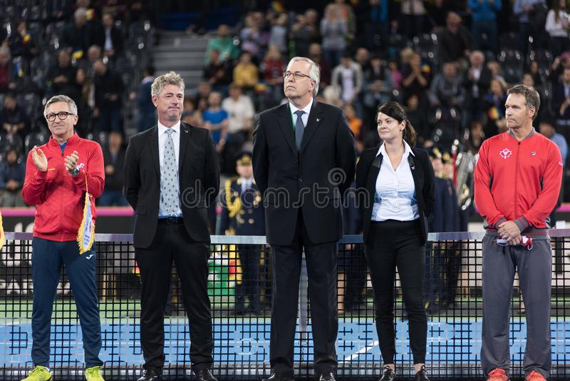 Tennis referees and captains. CLUJ NAPOCA, ROMANIA - FEBRUARY 10, 2018: Official referees and captains of Romania and Canada tennis teams entering the playground stock images