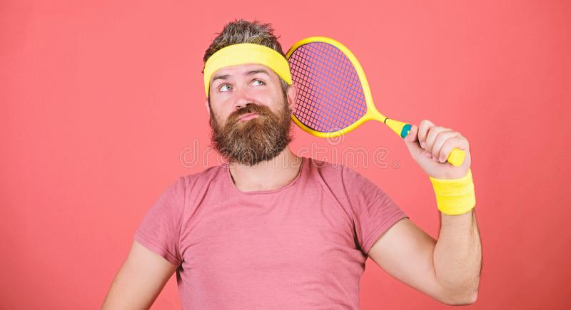 Tennis sport. Tennis club concept. Man bearded hipster wear old school sport outfit with bandages. Tennis can be an. Effective way to lose weight. Athlete hold stock photography