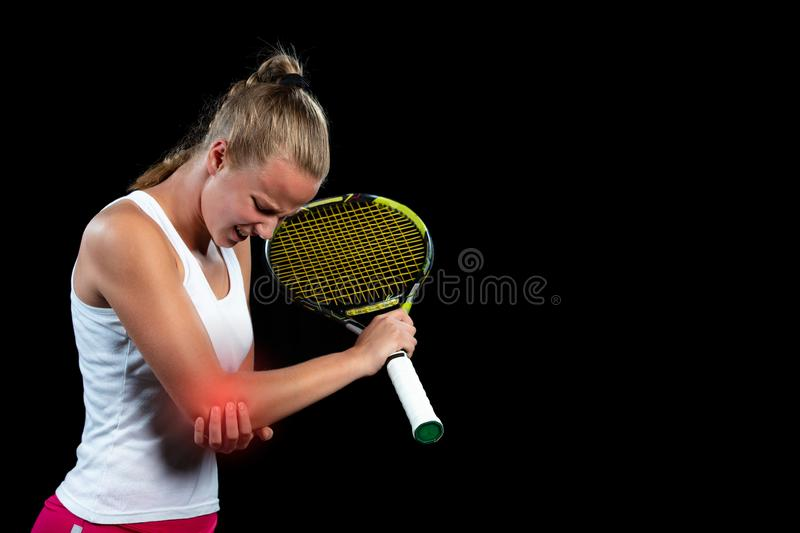 Tennis woman player with injury holding the racket on a tennis court royalty free stock images