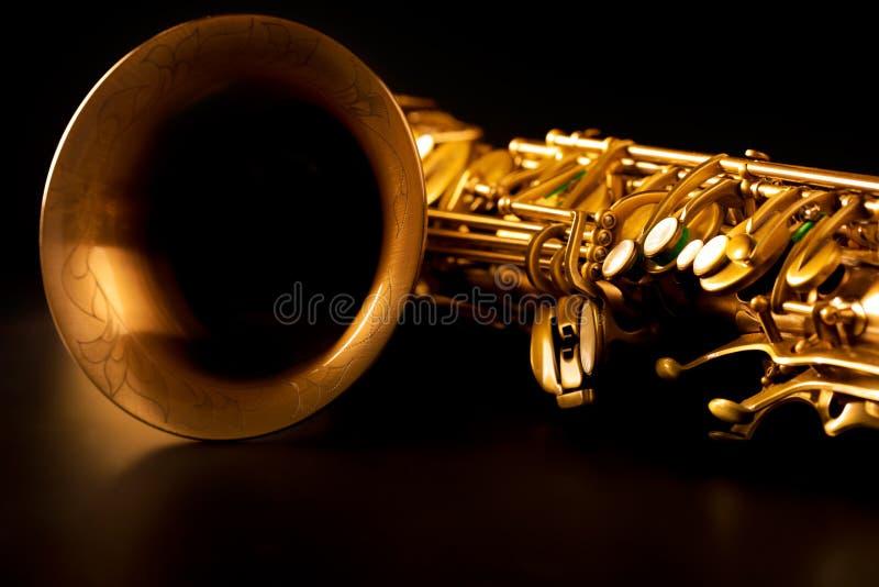 Tenor sax golden saxophone macro selective focus. Tenor sax golden saxophone macro with selective focus on black royalty free stock photography