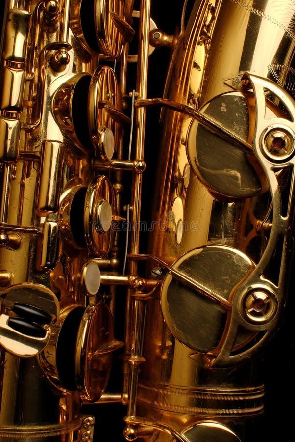 Tenor Saxophone close up. Close up of a golden tenor saxophone stock image