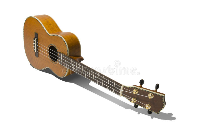Tenor Ukulele. Simple isolated image of a tenor ukulele setting on it's side with shadow royalty free stock photography