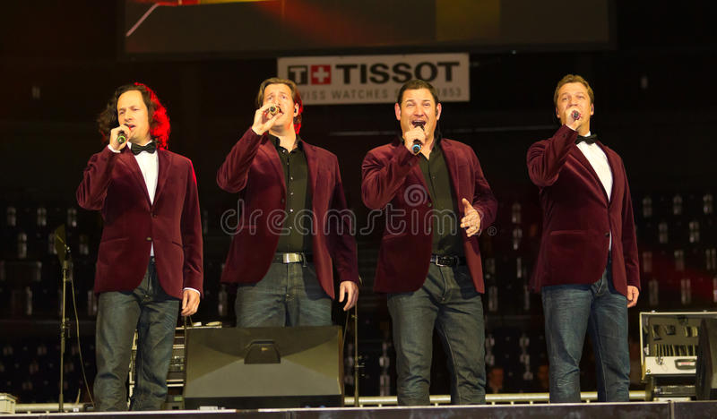 Tenors of I Quattro at Sixday-Nights Z�rich 2011. ZURICH-NOV. 30: Quartett Swiss star tenors of group I Quattro perform the showact at indoor bike challenge stock photo