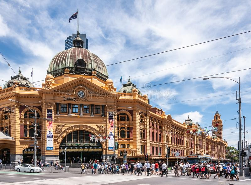 Tens of people cross street towards Flinders Railway Station n Melbourne, Australia royalty free stock image