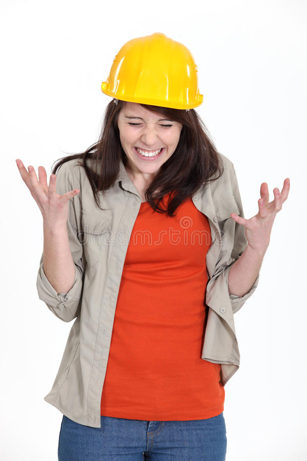 Tense constructon worker. A stressed brunette construction worker stock photo