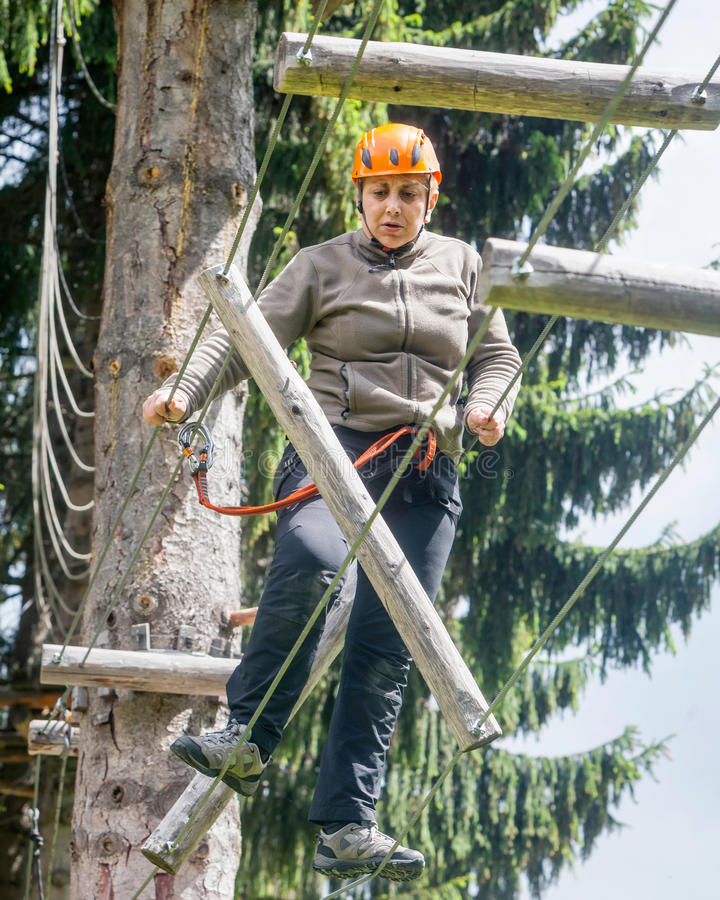 Tense Romanian Tourist Woman In Rausor Adventure Park stock photo