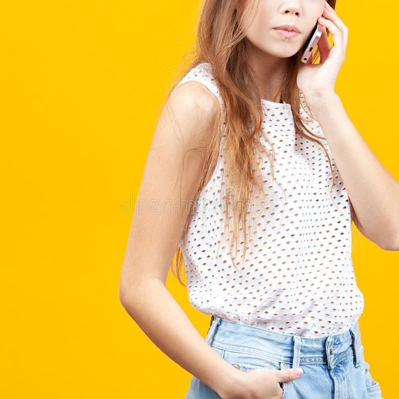 Tense young girl talking on phone. Emotions, communication and technology stock photo