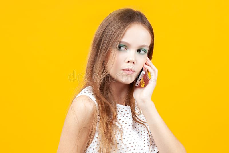 Tense young girl talking on phone. Emotions, communication and technology royalty free stock photo