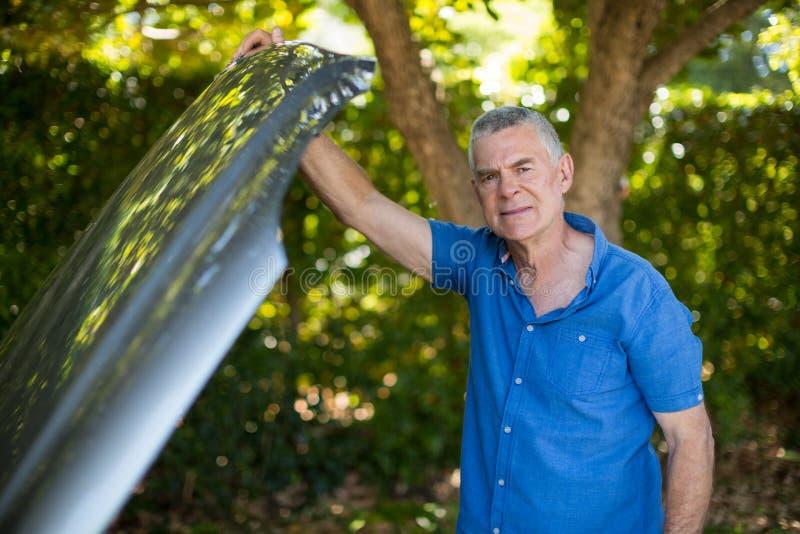 Tensed senior man opening car hood royalty free stock images